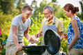 Family having a barbecue party in their garden in summer Stock Photography