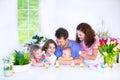 Family Having Breakfast On Eas...