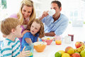 Family Having Breakfast In Kitchen Together Royalty Free Stock Photo