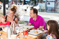 Family having brunch outside on a sunny day happy Royalty Free Stock Photo