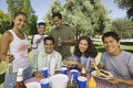 Family having food on a picnic boy with his happy Royalty Free Stock Photography