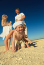 Family having fun at the beach Royalty Free Stock Photo