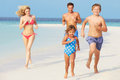 Family having fun on beach holiday playing Stock Photography