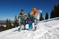 Family having fun on fresh snow at winter season happy vacation Royalty Free Stock Image