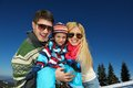 Family having fun on fresh snow at winter season happy vacation Stock Photography