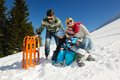 Family having fun on fresh snow at winter season happy vacation Royalty Free Stock Images