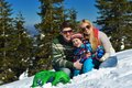 Family having fun on fresh snow at winter season happy vacation Royalty Free Stock Photography