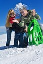 Family having fun on fresh snow at winter season happy vacation Stock Photos