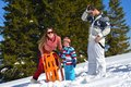 Family having fun on fresh snow at winter season happy vacation Stock Images