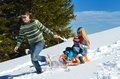 Family having fun on fresh snow at winter season happy vacation Royalty Free Stock Photos