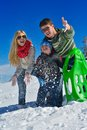 Family having fun on fresh snow at winter season happy vacation Stock Image