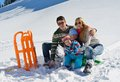 Family having fun on fresh snow at winter vacation season happy Royalty Free Stock Image