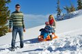 Family having fun on fresh snow at winter vacation season happy Stock Photography