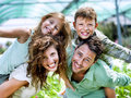 Family having fun in a greenhouse happy Stock Images
