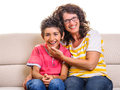 Family having fun at home mother boy happy on sofa and laughing smiling very happy Royalty Free Stock Image