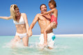 Family having fun sea beach holiday smiling Stock Images