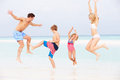 Family having fun in sea on beach holiday smiling Stock Images