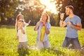 Family having fun with soap bubbles Royalty Free Stock Photo