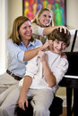Family having fun teasing teenage boy at home Royalty Free Stock Images