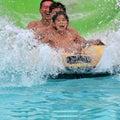 Family having fun at a water park Royalty Free Stock Photo
