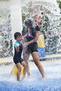 Family having fun in water park Royalty Free Stock Photo