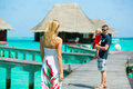 Family having tropical vacation of three in water villa at maldives Royalty Free Stock Photo