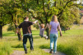 Family having a walk outdoors in summer Royalty Free Stock Images