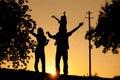 Family having walk at sunset Royalty Free Stock Photo