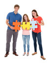 Family Holding Jigsaw Puzzle Pieces Royalty Free Stock Photo