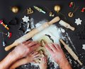 Top view of fathers and kids hands making Christmas cookies on b Royalty Free Stock Photo