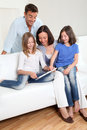 Family at home and technology Stock Photography