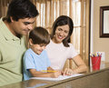 Family with homework. Royalty Free Stock Photo