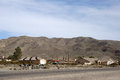 Family houses in barstow on a street with a mountain range the background Stock Photo