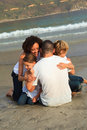 Family hugging on the beach Royalty Free Stock Images