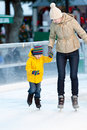 Family ice skating happy smiling mother and her cute cheerful son together at winter Royalty Free Stock Photography