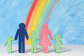 Family icons with a rainbow and blue sky Royalty Free Stock Photo