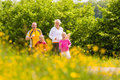Family jogging in the meadow for fitness Stock Photography