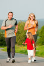Family jogging outdoors Stock Photos