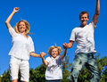 Family jumping in the air Royalty Free Stock Images