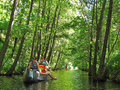 Family in kayak kayaking on a waterway mueritz nationalpark mecklenburg lake district germany Stock Photo