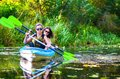Family kayaking, mother and child paddling in kayak on river canoe tour, active summer weekend and vacation Royalty Free Stock Photo