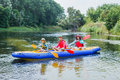 Family kayaking on the river Royalty Free Stock Photo