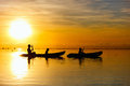 Family kayaking at sunset