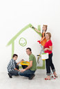 Family with kids painting their home Royalty Free Stock Photo
