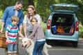 Family with kids and pet dog at picnic Royalty Free Stock Photo