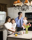 Family in kitchen. Stock Image