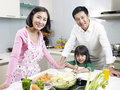 Family in kitchen asian of three smiling Stock Photo