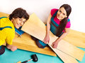 Family laying parquet at home happy Royalty Free Stock Photos