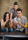 Family Learning To Play Video Games Stock Photography