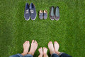Family legs in jeans and shoes standing  on grass Royalty Free Stock Photo
